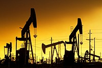 Oil Pumps at work in oil and gas field USA