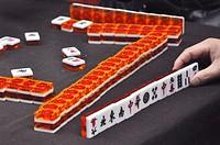 Yangshou (China): people playing Mahjong along a street