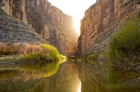 Sun setting behind Santa Elena Canyon on the Rio Grande river, border of United States and Mexico  Big Bend National Park, Texas, United States
