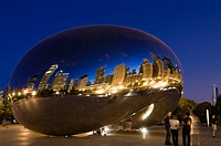 Reflections on the evening of the city of Chicago in the work ´Cloud Gate´ by British artist Anish Kapoor Indian origin