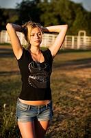 Sexy country girl posing on a Texas ranch