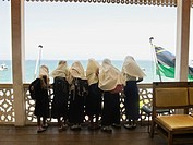 School girls looking at view from Palace Museum, Stone Town, Zanzibar