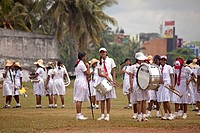 school girls in uniform, members of a marching band during a parade in Galle, Sri Lanka