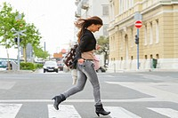 Attractive young woman running on the street