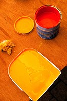 Red and orange paint for decorating an interior space