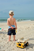Perdido Key Florida beach with boy playing in sand