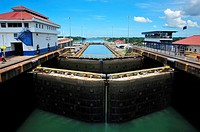 Panama Canal locks filling with water for passage of ship, Panama