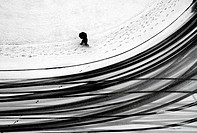 Snowy day, people and cars create patterns in snow, could be anywhere where snow falls, this one was taken in Geneva, Switzerland, from the roof of th...