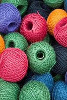 balls of multicoloured gardening twine in a basket