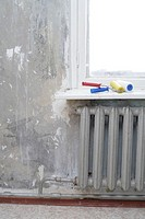 renovation of the room - painting rollers on the windowsill and vintage radiator