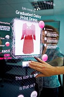 Interactive mirror that allows the person standing in front of it to see a simulated view of how the clothes they wish to buy would look when they wea...