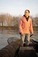 Alex Faget, professional fisher, fishing for the restaurant Les Tonnelles by chef Gérard Bossé: he identifies eel traps he made himself, Rochefort-sur...
