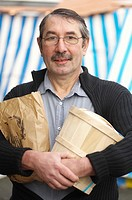 Gérard Bossé, chef of restaurant Les Tonnelles with jar of Échiré butter at market, Angers, Marne-et-Loire, Pays de la Loire, France