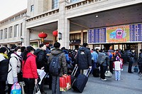 Beijing (China): workers buying a ticket at the train station to go back home for vacations during the Chinese New Year