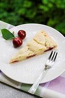 Cherry pie and cream cake slice