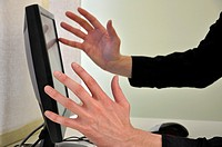 Frustrated businessman in front of computer focus on hands