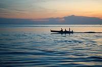 fishermen at sunset on Mabul Island, Borneo, Malaysia