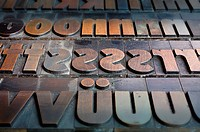 Old wooden letters for a letterpress printing press, type case with a bold poster font