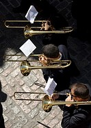 Members of music band performs in an Easter Holy Week procession in Cordoba, Andalusia, Spain, April 17, 2011