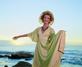 Sophisticated Senior Woman ´dances´ at seaside