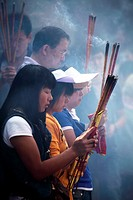 Prayers offer incense to Buddha in Yuantong Temple the famous Buddhist temple build during Tang Dynasty  Kunming  China.