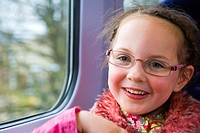 Happy 5 years old girl in the train
