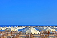 Umbrellas of the beaches on the beach of Arma di Taggia in Liguria on the Mediterranean