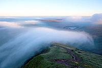 Orographic cloud forms around the summit of Pen-Y-Fan in The Brecon Beacons National Park, Powys, Wales, UK.