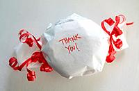 A wrapped gift with the words ´Thank You´ on it