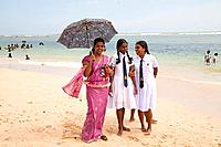 female teacher and schoolgirls at the beach in Polhena, Matara, LKA, Sri Lanka