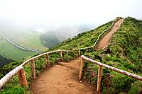 Empty walking trail in foggy weather nearby Sete Cidades crater  Sao Miguel island, Azores, Portugal