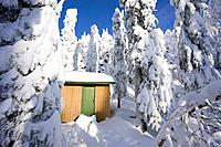 Storage shed in snowy forest Finland