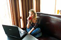 young business woman working on her laptop in a cafe