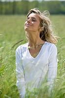 Beautiful woman enjoying sun and fresh air