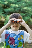 Boy looking through a pair of binoculars