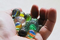 Hand full of marbles