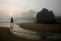 Sunrise on the beach Mamallapuran  In the background the temple  Mamallapuram, Tamil Nadu, India, Asia