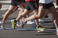 NEW YORK - NOVEMBER 7: The legs and feet of runners during the 2010 New York City Marathon