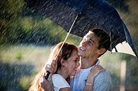 Couple in love in the rain