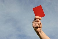 Hand of referee waving red card