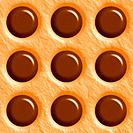 Dark chocolate and peanut butter polkadot tiling background texture pattern