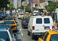 Traffic and pedestrians on crowded city streets in Manhattan in New York City