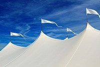 The top of a large white event tent in front of a blue sky  On the beach in Long Branch, New Jersey, USA