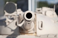Looking down the barrel of a gun on an old tank, a russian made T-55 at the imperial war museum in Manchester, England