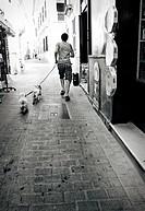 Man walking dogs. Ciutadella, Minorca, Balearic Islands, Spain