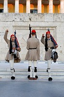 Greek presidential guards perform ceremonial duties in front of the unknown soldier.