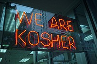 A sign in the window of a Dunkin Donuts in New York advertises that they are kosher and observe dietary Jewish laws