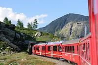 Train ride with Rhätische Bahn on the Bernina line from Ospizio Bernina to Poschiavo  Switzerland, Western Europe, Graubünden, Bernina, UNESCO World H...