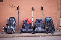 Rucksacks lined up on street