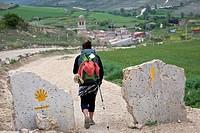 A pilgrim enters the village of Hontanas along the Camino de Santiago, route Frances